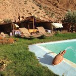 The pool and Berber tent area in the garden