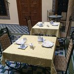 Tables set for breakfast in the courtyard