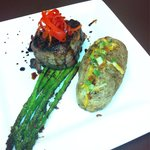 Bacon wrapped stacked sirloin steak, served with blanched asparagus and loaded baked potato.