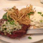 Flat Iron Steak topped with goat blue cheese, mashed potatoes, garlic spinach, and crispy fried