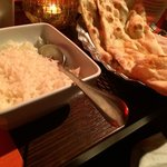 Basmati rice and one of the three different naan breads we ordered ...