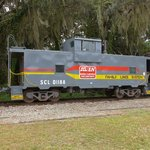 Freshly repainted caboose 01188 is among the train consist on a rainy Sunday morning.