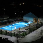 Night view of the pool. They have a fire pit too.