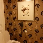 Toilet room. Elegant wallpaper