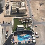 parking lot iwth swimming pool of the apartment hotel
