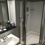 Clean well presented bathroom with shower and bath