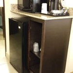 Refrigerator, microwave and coffee-maker.