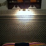 Bedroom interior with Moroccan tilework. The bed was perfectly made before the picture was taken