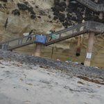 some of steps to the beach, with gym equipment hanging from the bottom