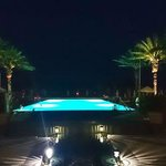 The adult pool on the pool deck at night