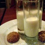 tiny glasses of fresh milk and mini cookies courtesy of chef