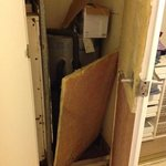 cupboard in bedroom with rubbish