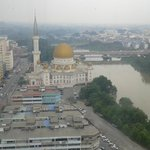 the day view of the town mosque beside the river