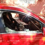 Car damage from robbery at night - hotel car parking