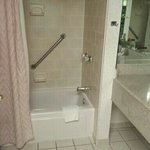 Clean bathroom with hot water and good pressure.