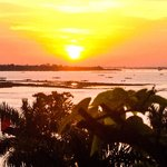 sunrise over Tongle Sap river from Bouganvillier Hotel
