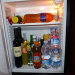 Mini Bar fridge. Somel water and ice tea bottles were ours