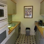 Compact kitchen includes clothes washer/dryer