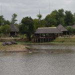 looking at the lodge from across the waterhole - with resident hippos in the foreground