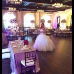 Beautiful bride seeing the banquet room for the first time