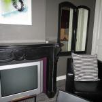 Chair, TV and wardrobe