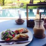Eggs Benedict and coffee shake for breakfast by the pool