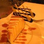 Dessert, a caramel-laced, custardy cheesecake with chocoloate lattice.