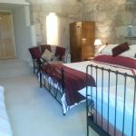 The Pele Tower room made up ready for a family of four