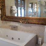 Four poster bed bathroom with jacuzzi bath