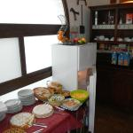 Breakfast area laden with variety of cereals, fruits, yogurt & baked goods