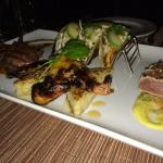 Our Appetizer consisting of grilled lamb, shrimp tacos, seared ahi and grilled quail