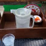 pitcher of water with fruit and menus given to guests when at the pool