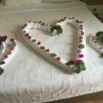 Towels arranged by maid with flowers
