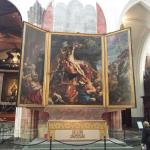 My wife is dwarfed by one of the five Rubens' masterpieces within the cathedral.
