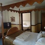 Our room with four poster bed
