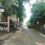 The lane leading from hotel gate to Gate 2 of Sai Temple