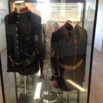Display of British Army uniforms.