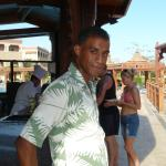 KHALED our waiter at the pool bar eating lunch with us