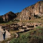 Tyuonyi pueblo against the cliffs of the Frijoles canyon