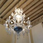 Timber ceiling detail and Murano glass chandelier