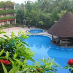 Typical view from bedroom overlooking pool and garden area