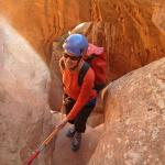 Canyoneer at the start of a spectacular arch rappel at Hogwart's Canyon.