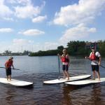 The family does paddle boarding
