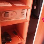 Digital safe in the room and shoes to wear within the room