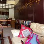 Lobby, kitchen, comfy couch and plenty of books...