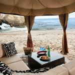 Lay beachside in a Cabana