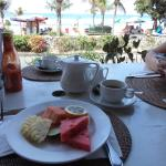 Having breakfast with a great view of the beach.