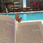 Reading by the pool before my swim