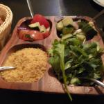 Cucumbers in dill, tomato basil salad, cous cous, fresh greens and baby potatoes.