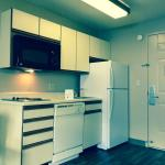 Kitchen in room!! Stove Top Range, Hardwood Floors, Full Sized Fridge, plenty of storage space a